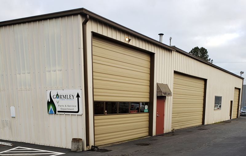 Find Gormley Plumbing + Mechanical's retail store entrance behind the Corporate Office building in McMinnville, Oregon.